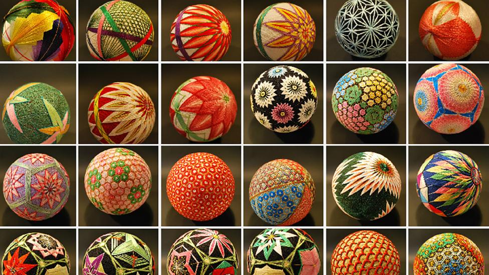 A selection of colourful thread wrapped balls