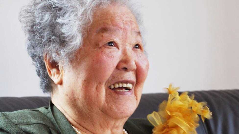 Photograph of an elderly Japanese lady smiling