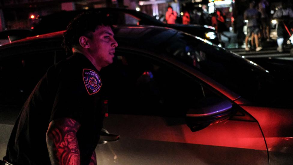 NYPD officer during power cut in Manhattan