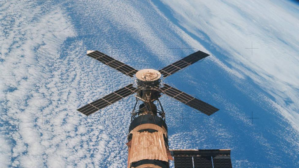 A solar array from the space station flies above Earth (Credit: Nasa)