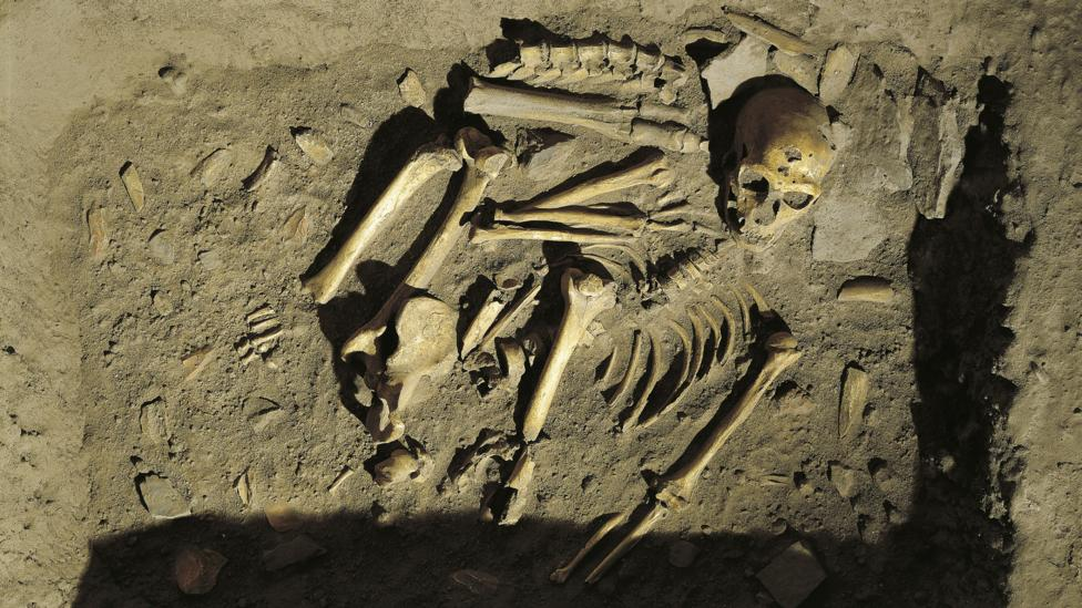 A reconstruction of a Neanderthal burial in France (Credit: Getty Images)