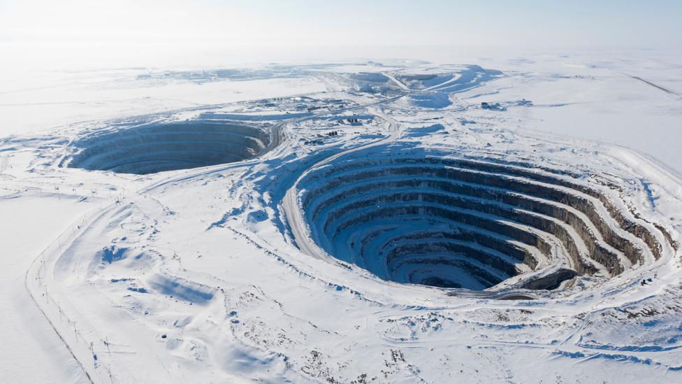 Diamond mining can involve the removal of vast amounts of earth and rock which creates holes so big they can be seen from space (Credit: Alamy)