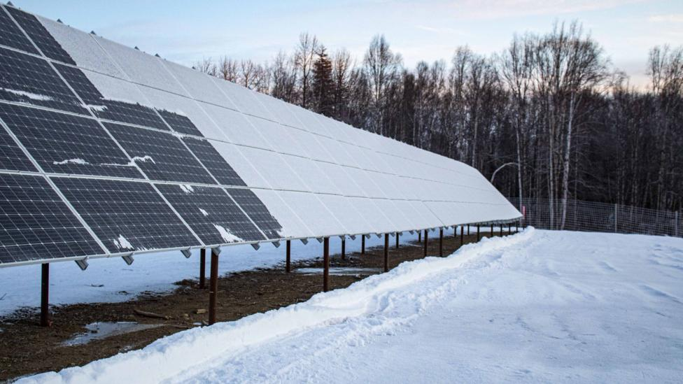 Snow obstructing the sunlight can put solar panels out of action, and requires regular clearing in colder months (Credit: Fischer Knapp)