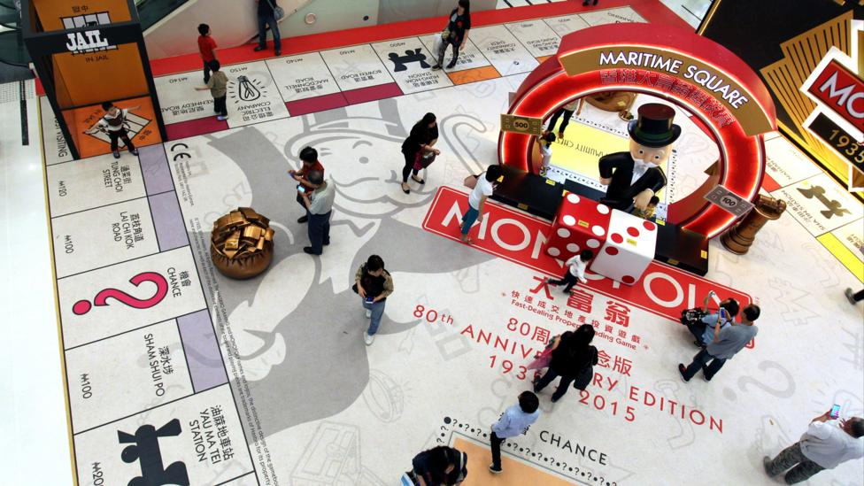 Shoppers in China walk over a giant version of the game (Credit: Getty Images)