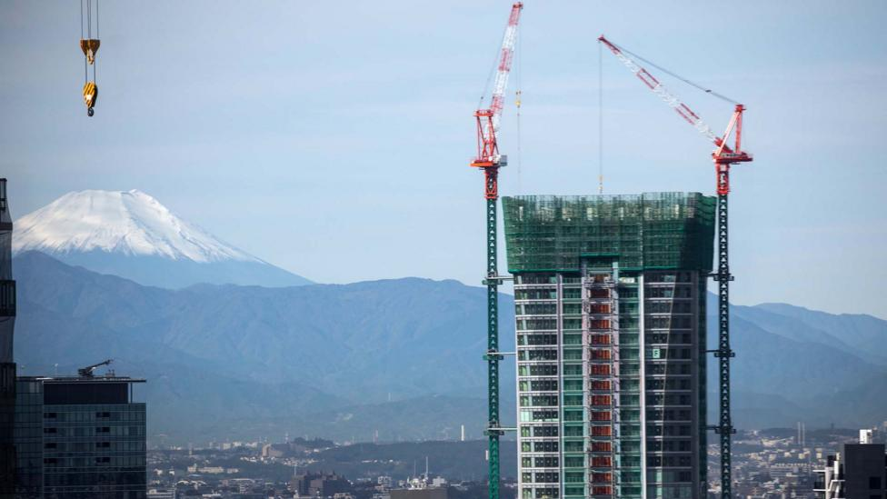 Construction in Tokyo has been booming thanks to playing host to major sporting event (Odd Anderson/AFP/Getty Images)