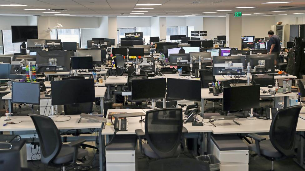 A nearly empty office in Boston, Massachusetts on 10 March after staff was asked ot work from home (Credit: Getty Images)