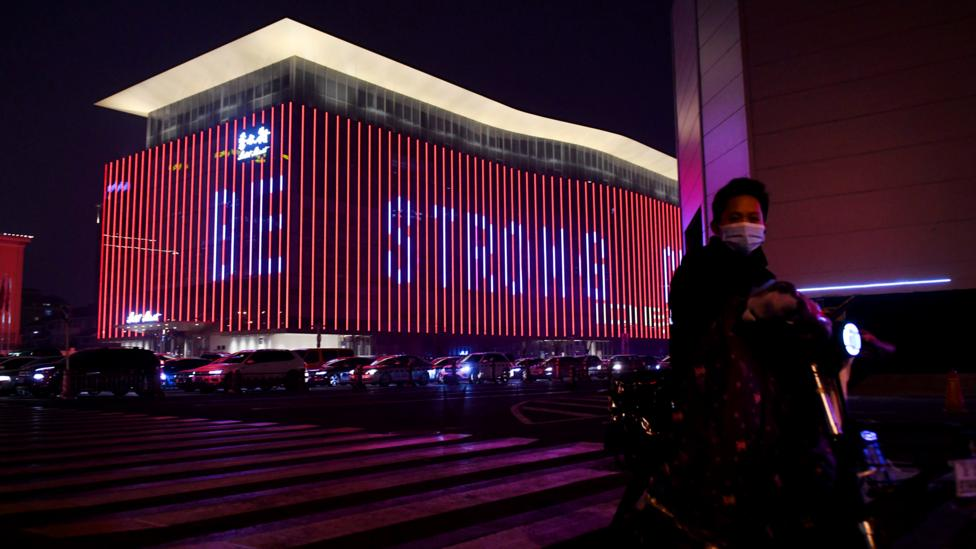 "A message of support which reads ""Be Strong China"" is seen on a building in Beijing amid the country's Covid-19 coronavirus outbreak (Credit: Getty Images)"