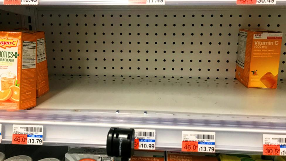 Empty vitamin shelves in a supermarket (Credit: Reuters)