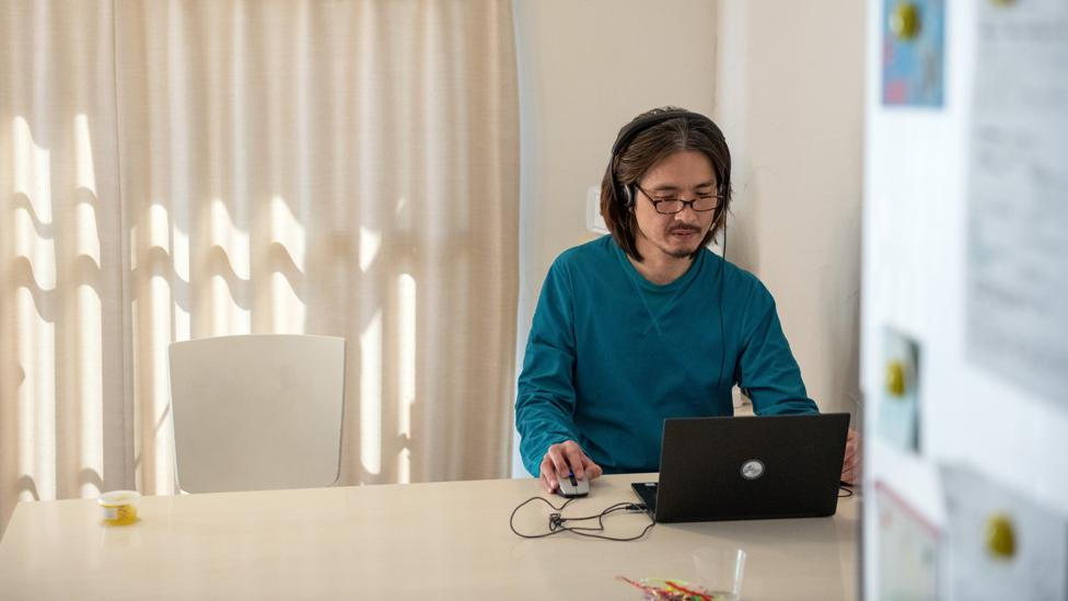 It's harder to stay on task without physical barriers between work and home life, but it's certainly not impossible (Credit: Getty Images)