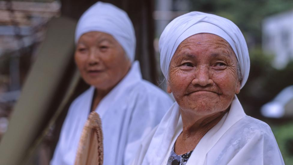 Social interaction and spirituality were both found to be common among 100 year olds in places like Okinawa (Credit: Alamy)