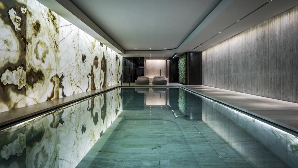 Dutch design company SolidNature's basement swimming pool, created with back-lit golden onyx (Credit: SolidNature)