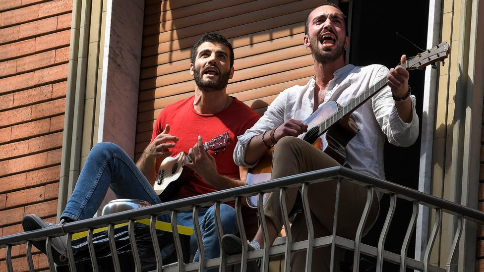 Many residents in lockdown in Italy have been playing instruments and singing on their balconies (Credit: Getty Images)