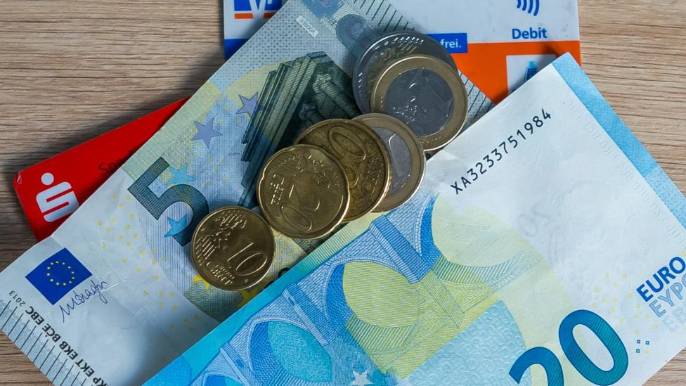 Cash and German bank cards on 25 March 2020