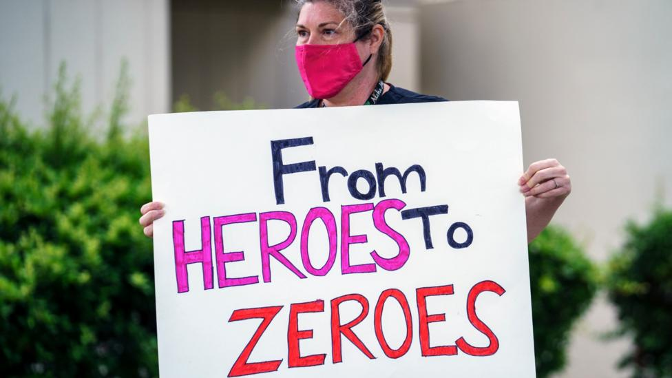 In some cases the language being used isn't appreciated: this US healthcare worker is protesting against a lack of PPE
