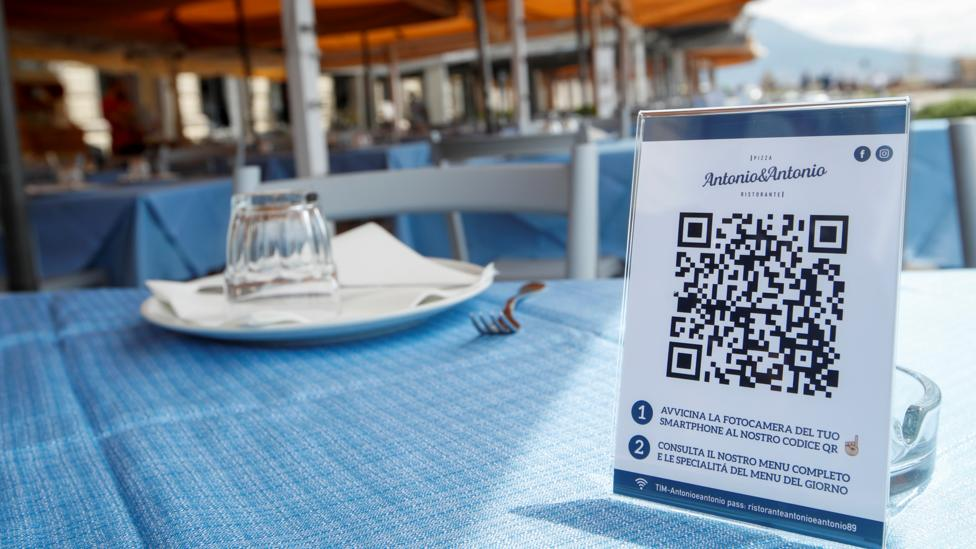 Some restaurants are turning to QR codes for touch-free ordering, as at this restaurant in Naples, Italy (Credit: Reuters)