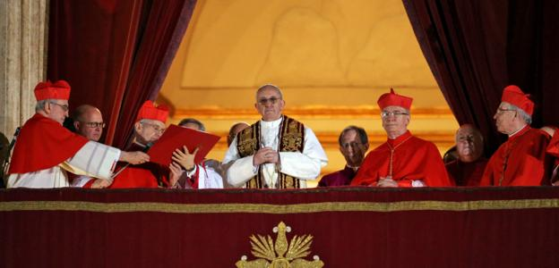 The new pope surrounded by cardinals.