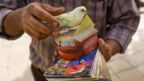 In Tehran, Iran, people have their fortunes picked at random by canaries